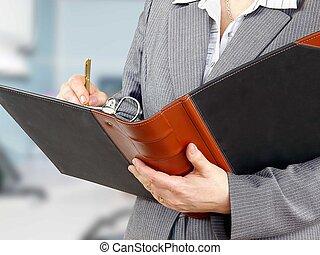 Businesswoman filling a form