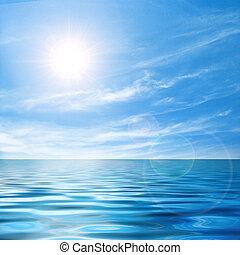 Beautiful seascape with bright sunlight and calm sea