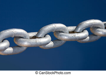 Close up of large silver coloured links in an industrial chain