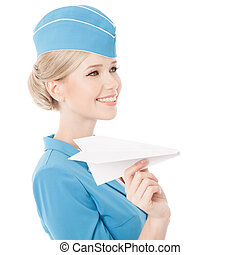 Charming Stewardess Holding Paper Plane In Hand. Isolated On White Background.