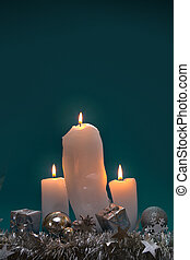 Christmas background with three white candles for Advent.