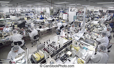 overview of clean room manufacturing with unidentifiable masked workers