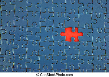 Close up of a Blue Jigsaw with missing piece