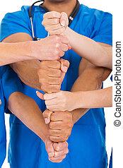healthcare workers hands together