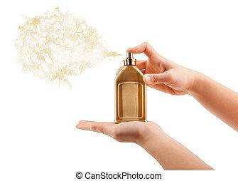 woman hands spraying perfume
