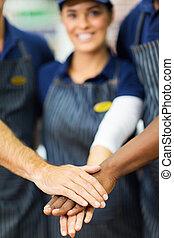 supermarket workers hands together