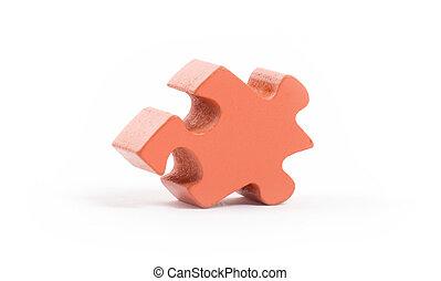 Closeup of big orange jigsaw puzzle piece