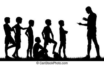 Editable vector silhouette of a man coaching children football