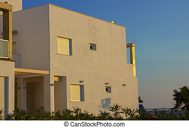Color white modern house at sunset