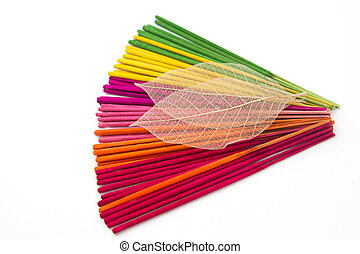 Colorful aroma incense sticks for spa treatment with dry leave