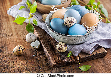 Colorful Easter eggs on wooden surface