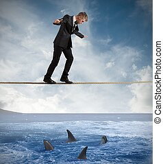 Concept of risk with businessman and shark