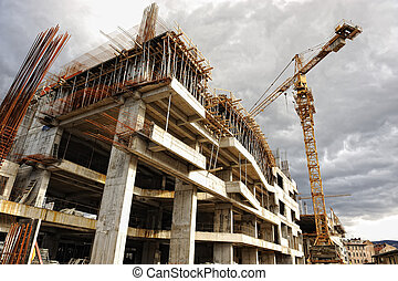 Construction site with crane and building
