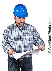 Construction worker holding blueprints