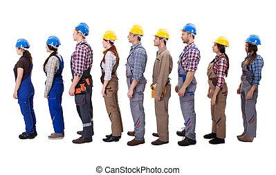 Construction workers standing in queue
