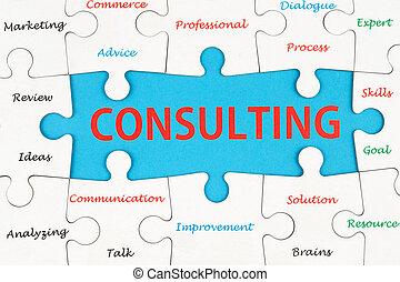 Consulting concept word cloud on group of jigsaw puzzle pieces