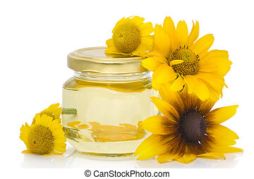 Cosmetic curative oil from yellow flowers. Isolated on white.