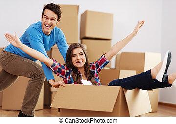 Couple having fun in new home
