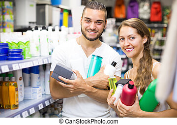 Couple with shampoo in the store.