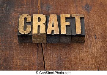 craft word in vintage letterpress wood type against grunge weathered wooden background