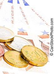 crisis of euro-zone, euro coins on 50-euro banknotes