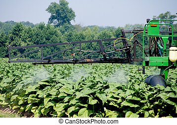 A large commercial crop spraying farm tractor.