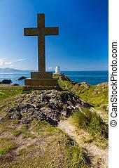 Cross and lighthouse on Llanddwyn Island, Anglesey