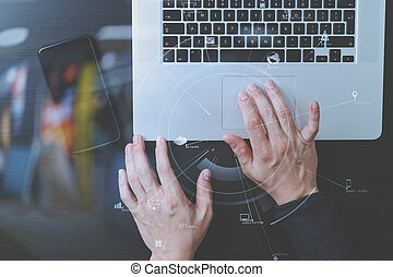 cyber security internet and networking concept. Businessman hand working with VR screen padlock icon mobile phone on laptop computer background