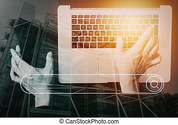cyber security internet and networking concept. Businessman hand working with VR screen padlock icon mobile phone on laptop computer background with buildings exposure
