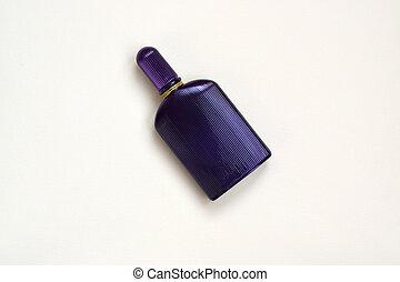 Dark purple perfume bottle with golden ribbon on pastel paper background. Trendy fragrance