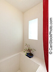 Deep tub shower with window in white tile