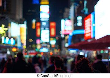 Defocused blur of New York City lights on Times Square