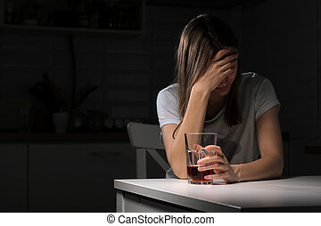 Depressed sad young addicted woman feeling bad drinking whiskey alone at home, stressed frustrated lonely female drinker alcoholic suffer from alcohol addiction having problem, alcoholism concept.