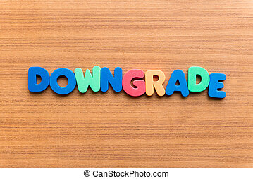 downgrade colorful word on the wooden background
