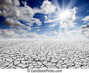 Colorful dramatic landscape with cracked soil and blue sky