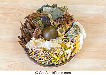 Dried Chinese mixed herbs to make cooling drinks in traditional Chinese medicine on wooden background