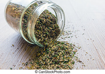 Dried mixed herbs in a glass jar