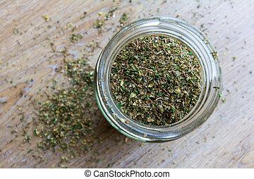 Dried mixed herbs in a jar
