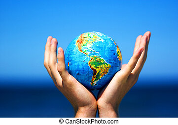 Earth globe in hands. Conceptual image