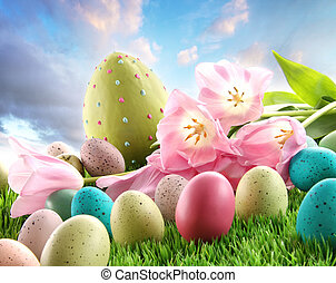 Easter eggs with tulips in the grass