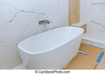 Elegant bathroom with bathtub in new home bathroom renovations
