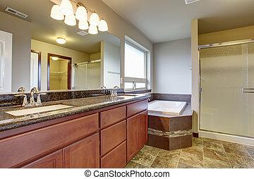 Elegant master bathroom with tile floor.
