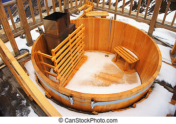 empty wood tub in snowy day