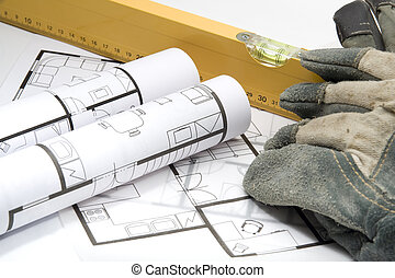 Builder's equipment - blueprints of architecture interior, builder's level and protective gloves