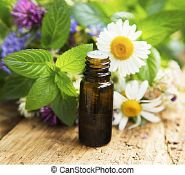 Essential Oil with Medicinal Herbs and Flowers for Alternative Therapy