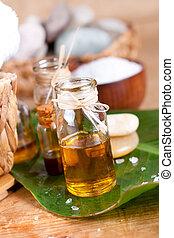 Essential oils, zen stones, salt, over wooden surface