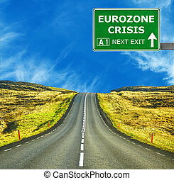 EUROZONE CRISIS road sign against clear blue sky