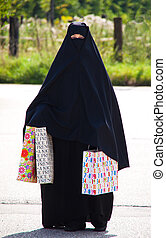 Example picture Islam. Muslim burqa is with obscured.