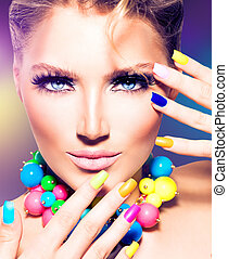 Fashion beauty model girl with colorful nails