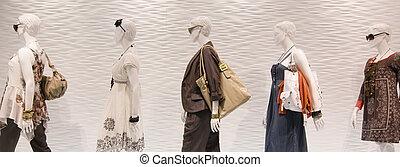 Fashion mannequins in window